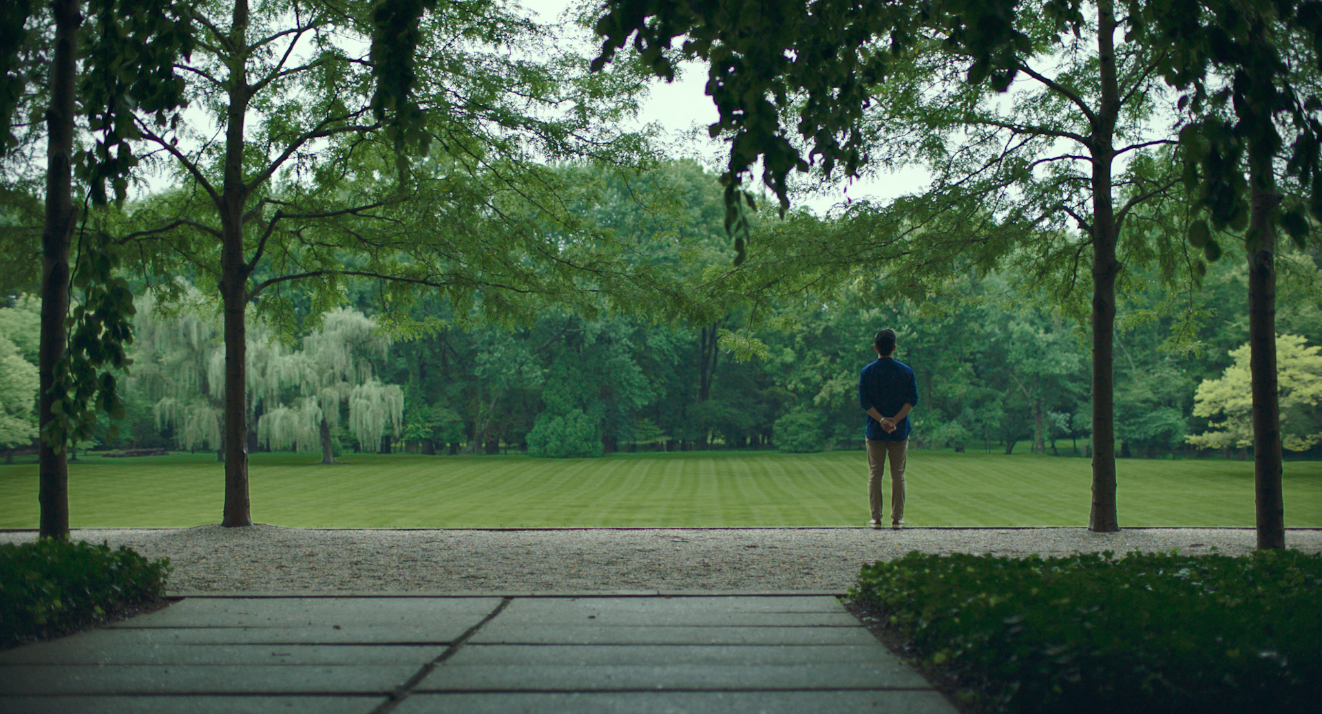 John Cho looking at landscape in Columbus