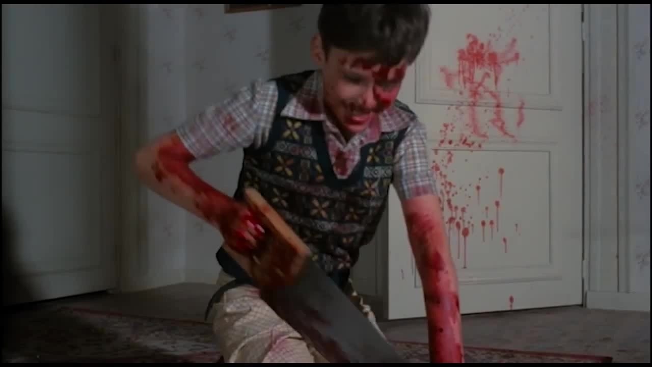 Boy with bloody saw in Pieces