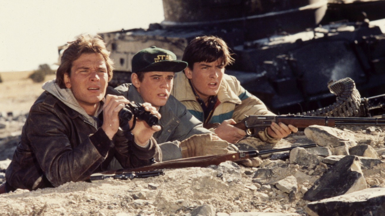Patrick Swayze, C. Thomas Howell, and Charlie Sheen in Red Dawn (1984)