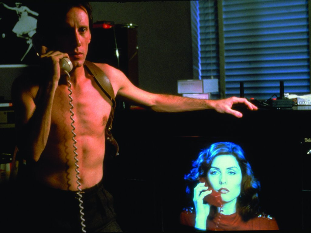 James Woods and Debbie Harry on phones in Videodrome