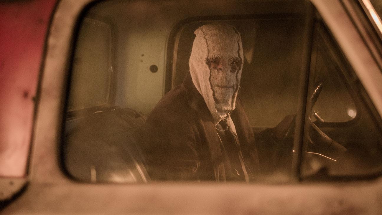 Strangers Prey At Night masked in car