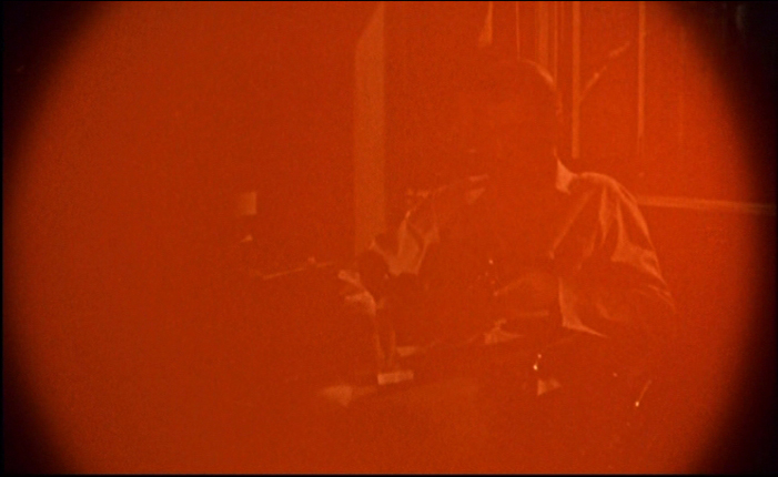 Hitchcock Rear Window camera flash